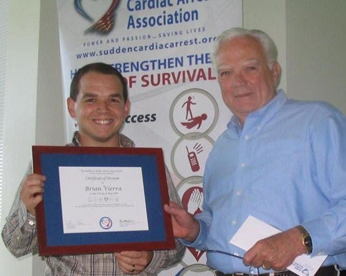 Jack Grogan presents the SCAA HERO AWARD Plaque and HERO pin to Brian Vierra who has helped save two lives.